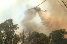 Waterbomber helps fight Perth Hills fire