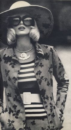 Snail necklace! Want.  Channel the ultimate 70s glamour with loose pincurls like Gunilla Lindblad, shot by Helmut Newton, 1972.