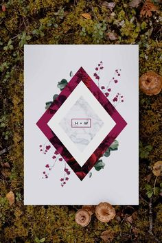 Stunning burgundy and green botanical Wedding Invitation by Sail and Swan Studio. The design features a burgundy red geometric diamond shape, with green native leaves, greenery and burgundy botanicals.