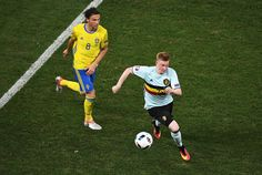 Kevin De Bruyne of Belgium takes the ball, away fromm Albin Ekdal of Sweden during the UEFA EURO 2016 Group E match between Sweden and Belgium at Allianz Riviera Stadium on June 22, 2016 in Nice, France.