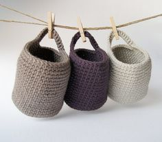 Set of 3 hand-crocheted baskets made from wool yarn in taupe, ecru and violet by Barcelona shop Mari Cati Monsina .  She will make them i...