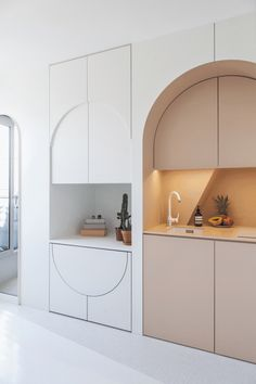 Kitchen Interior Design Built-in drop leaf table in arched Parisian apartment. - And psst! You can rent it Micro Apartment, Small Apartment Design, Small Room Design, Design Room, Apartment Interior Design, Small Apartments, Interior Design Kitchen, Small Spaces, Interior Decorating