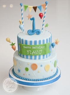 Blue first birthday cake with colore balloons