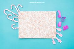 Celebration composition with paper and candy canes Free Psd