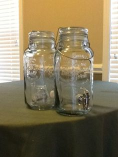 3 qt. drink dispensers that look like mason jars.  Worked great for serving lemonade and sweet tea at our country fair themed wedding in June.