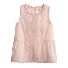 J.Crew - Girls' mini pom-pom sleeveless eyelet top: $48, available in sizes 5 and 7 to 12 years. J.Crew: $$, local Cville franchise & online