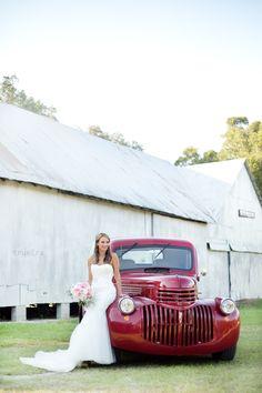 Bride  | True Era Photography #weddingphotography #weddingphotographer #wedding #vintage #truck #red #bride #roses #bouquet #weddingdress #beautiful #countrywedding #barn