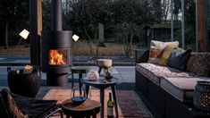 Relaxing summer evenings can be prolonged and enjoyed with a cosy outdoor fireplace to add a unique ambiance. We have some stunning outdoor gas fireplace. Outdoor Spaces, Outdoor Living, Outdoor Decor, Pool Organization, Modern Outdoor Fireplace, Standing Fireplace, Fire Doors, Backyard, Patio