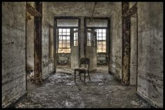 Abandoned children's insane asylum.  This picture is creepy...can you see the eyes staring back at you?