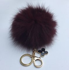 A personal favorite from my Etsy shop https://www.etsy.com/listing/250749928/new-vine-fw15-fox-fur-pompon-bag-charm