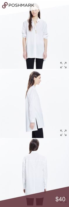 """Madewell Streetview Tunic Shirt - Size S Sleek and supercool, this is the timeless white button-down evolved. High side vents and a versatile tunic length make this shirt so easy to layer with jeans and skirts alike (full-tuck, half-tuck, no tuck, it all works).  Slightly oversized fit. Cotton. Machine wash. Import. Item E7477.  In excellent used condition.  From a smoke free home.  Measurements: 21.5"""" across, 27.5"""" length, 21"""" sleeve. Madewell Tops Button Down Shirts"""