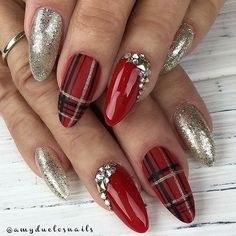 Christmas nails with gold and red gel polishes. Red and black and white paid design and rhinestones! Beautiful nails by Ugly Duckling Master Educator @amyduclosnails - Grandma Wendy with some Christmas plaid Using exclusively Ugly Duckling Products Ugly Duckling Nails page is dedicated to promoting quality, inspirational nails. Tag us and m