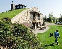 Earth house - underground monolithic dome home with retaining wall home