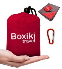 Compact Waterproof Pocket Beach Blanket by Boxiki Travel. Portable Lightweight Folding Tarp with Red Travel Case. Outdoor Picnic Camping Blanket with Easy Attachment Clip Accessory. ✅ VERSATILE BLANKET. Waterproof beach blanket is ideal for outdoor fun; compact pocket tarp is suitable for any occasion to be used by the entire family. Folding blanket can be used in multiple sizes, folded neatly or opened wide. ✅ DURABLE. Picnic blanket is made with nylon fabric for long-lasting, waterproof...
