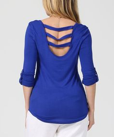 Step out in of-the-moment style in this stretch-enhanced pick boasting a trend-right cage back.Size S: 25'' long from high point of shoulder to hem 95% rayon / 5% spandexMachine washImported