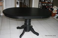 Great repainted table ~ I used the Valspar Satin paint in Black (I forgot to take the picture of the can before I painted with it). This product comes pretinted so it is a nice deep black. It is a water based, roll on paint that goes on really thin but sticks like spray paint. I loved that I could still see the grain of the wood through the paint. I did 5 thin coats