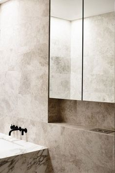 Bathroom in natural beige stone - Anderson Street House, South Yarra by Travis Walton Architecture & Interior Design