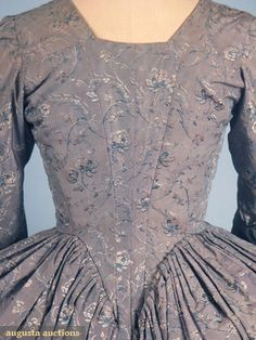 BLUE SILK BROCADE DRESS (back view), c. 1775-1790, England. Steel blue ground w/ meandering allover small floral pattern in French blue & ivory, 3/4 sleeves. Augusta Auctions