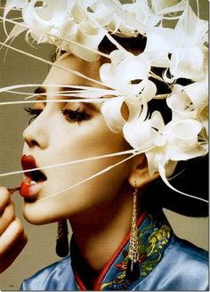 Geisha- applying makeup... love this idea and the focus on flower hair piece