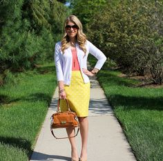 Yellow polka dot skirt and coral top with white cardigan..the perfect business casual outfit!  Click through to this site for more office outfit ideas!