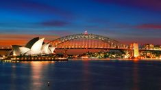 What to do in Sydney for in seven days: The Sydney Opera House and Sydney Harbour Bridge at sunset.