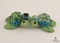 Turtles Wedding Cake Topper. This handsome couple is sure to make you smile. Hand sculpted and hand painted, they make the perfect keepsakes.  All of my works are non-toxic and can last a lifetime with proper care, a perfect keepsake from your special day.  The groom is 3 wide both will fit on a 6 round.  ♥♥♥♥♥♥♥♥♥♥♥♥♥♥♥♥♥♥♥♥♥♥ What I need to know:  ♥ Your due date ♥ Color of accessories and turtles if different from the image shown. ♥ If you want flowers, which will be attached to the…