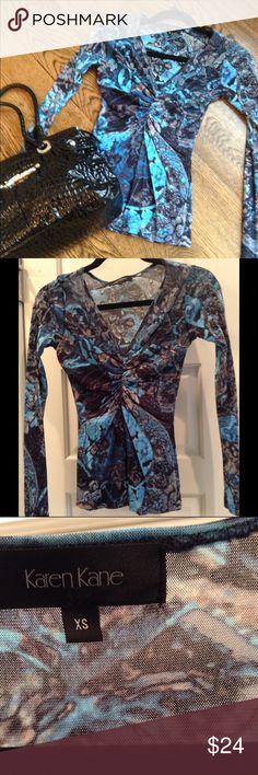 Karen Kane Blue and Black print ruched front top Blue and Black Karen Kane top.  Very figure flattering fit. Karen Kane Tops Blouses