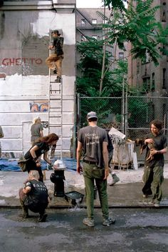 Ghetto. 1994 5th St. Squat. Residents are priming over the graffiti and old paint, preparing to apply fresh paint to the building front.