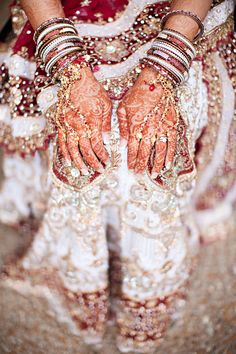 cultural real wedding Indian weddings Chicago IL gold red mahogony bride wears henna layers of bangl