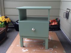 My first Ikea hack! Started with the unfinished pine Tarva nightstand, primed, and painted in a sage green (satin gloss).  Bonus: switched out the wood ikea knob for a mercury glass knob from World Market.