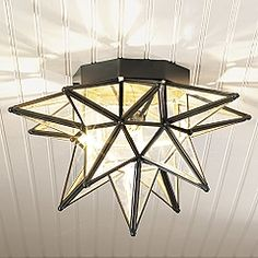 A unique glass starburst light hangs above the sitting area our moravian star lighting recreates that traditional form in clear glass and steel with hand applied bronze finish ceiling mozeypictures Choice Image