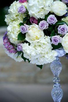 white hydrangeas and purple roses