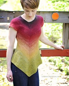 A simple, asymmetrical tee designed to accentuate the impact of gradient dyed yarns. This cap sleeved sweater has a hi-lo, straigh back and a-line, chevron pointed front. It is knit seamlessly from the top down, minimizing finishing work. Easy enough for an advanced beginner.