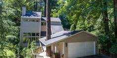 Light and Bright Hillsdale Contemporary. Nestled in the trees, this lovely home features soaring vaulted ceilings, abundant windows providing natural light throughout the home, a spacious kitchen with slider to large covered deck overlooking beautiful