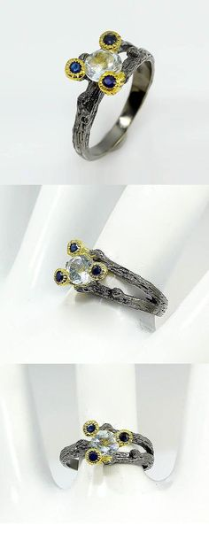 Aquamarine ring, twig branch ring Birthstone March, branch promise ring sapphire, blue gift mom, blue gift wife, sister gift, black ring  This is a statement sophisticated two tone branch ring in Black and gold colors. The ring features an amazing white (very light blue but sooo brilliant in sparkle!) aquamarine genuine gemstone from Africa. It is truly stunning with tiny blue sapphire berries on branches around it to make the stone shine and give all it's beauty.