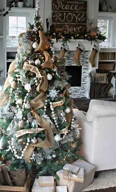 """rustic natural looking Christmas tree except I would use """"Merry Christmas"""" instead of """"Happy Holidays""""."""