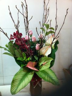 Vase arrangement - Antheriums, Roses, Cymbidium Orchids, Pussy Willow and leaves