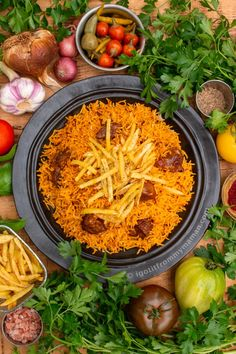 Estamboli Polo is a flavourful Persian rice dish with tomato paste and spices in it, topped with crispy potato fries. Persian recipes from igotitfrommymaman.com Goat Recipes, Clean Recipes, Cooking Recipes, Healthy Recipes, Clean Meals, Rice Recipes, Crispy Potatoes, Sliced Potatoes, Easy Delicious Recipes