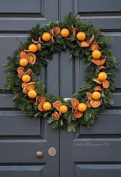 Williamsburg Christmas, by John Bowman - Citrus - Christmas Kitchen Decorating Ideas Christmas Door Wreaths, Noel Christmas, Primitive Christmas, Christmas Crafts, Christmas Decorations, Holiday Decor, Christmas Oranges, Christmas Ideas, Xmas