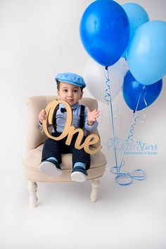 Baby boy celebrating his first birthday. Star Photography, Children Photography, One Year Old Baby, Blue Balloons, Baby Boy Birthday, Birthday Celebrations, One Star, First Year, Birthday Dresses