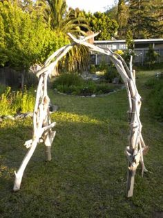 CEREMONY ALTAR DECOR-- diy driftwood arch would be a fun (& long) project but with more than a year before our wedding I think it could be do-able!!(however I think ours would be more like a house facade, with two tall sides and a roof like top)
