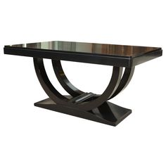 Art Deco Dining Table in Ebonized Walnut | From a unique collection of antique and modern dining room tables at http://www.1stdibs.com/furniture/tables/dining-room-tables/