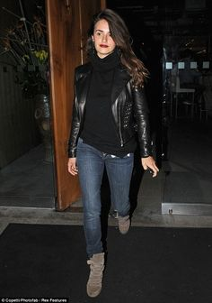 Night out: Penelope pairs casual blue jeans with a black jumper and a studded leather jacket for her night out at Zuma