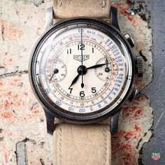 : This Heuer chronograph has a tachymeter scale to measure speed over a measured mile or kilometer and a telemeter scale to compute the distance of artillery fire. Camera Watch, Authentic Watches, Tag Heuer, Watch Sale, Vintage Watches, Watches For Men, Unique Watches, Vintage Men, Jewelry Watches