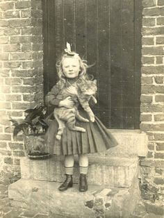 Vintage girl with her cat