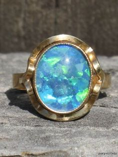 Blue mosaic patterned opal in gold. A lovely ring! #opalsaustralia