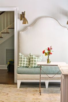 High back nailhead bench + brass sconces
