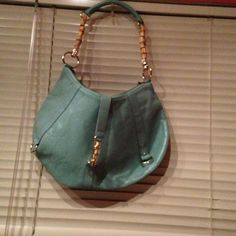 Aqua Banana Republic purse. Banana republic bag great condition and great color :) Banana Republic Bags