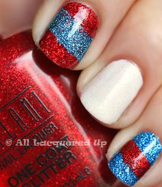 Patriotic Manicure with Milani One Coat Glitters.  This is China Glaze Cloud Nine over China Glaze Snow plus Milani Red Sparkle and Milani Blue Flash.  Absolutely freaking AMAZING.