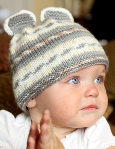 Free Knitting Pattern for Easy Mouse Baby hat - Easy baby hat with mouse ears. The color pattern comes from the multi-colored self-patterning yarn. Rated easy by designer and Ravelrers.  Designed by Vanessa Ewing for Plymouth Yarn.